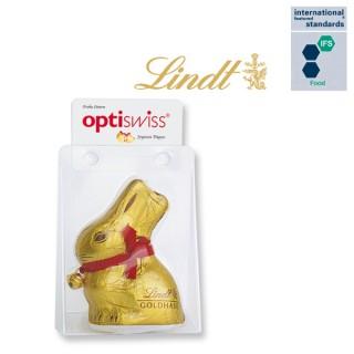 Durchsichtige Druckknopfverpackung mit Lindt Goldhase und Werbung auf Karte