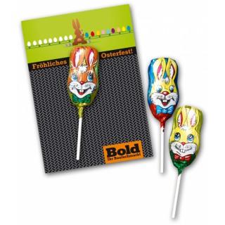 Schokolutscher in Hasenkopf-Form in Alufolie wird auf Ihre personalisierte Karte aufgebracht. So günstig und effektiv geht Werbung zu Ostern.