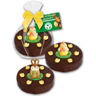 Küken und Hase als Zuckergussdekoration auf Baumkuchenring im Glanzbeutel mit bedruckter Karte als Werbegeschenk